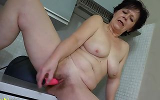OldNanny granny mature wank with orange faux-cock